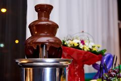 Chocolate fountain on the holiday table royalty free stock images