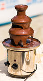 Chocolate fountain placed on a table in wedding Stock Image