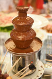 Chocolate fountain placed on a table in wedding day Royalty Free Stock Image