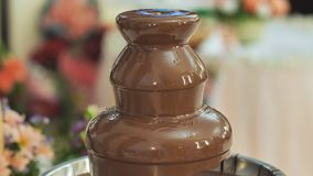 Chocolate fountain at a wedding celebration.
