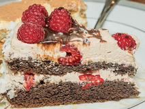 Chocolate Framboise Layer Cake. Chocolate layer cake decorated with fresh raspberries Royalty Free Stock Images