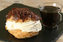 Chocolate and fresh cream choux bun Royalty Free Stock Photography