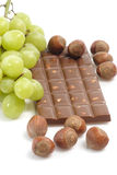 Chocolate with fresh grapes Royalty Free Stock Image