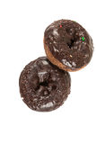 Chocolate frosted cake donuts Stock Photos