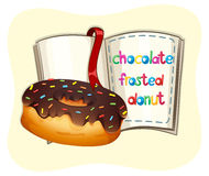 Chocolate frosted donut and a book Royalty Free Stock Image