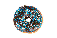 Chocolate Frosted Donut on White Background. Chocolate Frosted Donut with Sprinkles Isolated on White Background royalty free stock photography