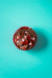 Chocolate Frosting Cupcake with Candy Heart Sprinkles for Valent Stock Image