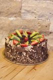 Chocolate fruit cake. On wooden table royalty free stock images