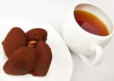 Chocolate fruitcake and cup of tea Royalty Free Stock Image