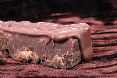 Chocolate fudge on brown background Royalty Free Stock Photo