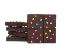 Chocolate fudge brownies with candy pieces stock image