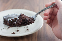 Chocolate Fudge Brownies on a fork. Chocolate Fudge Brownie on a fork from the perspective of a person eating it Royalty Free Stock Image