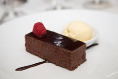 Chocolate Fudge Dessert with Raspberry and Ice Cream Royalty Free Stock Photography