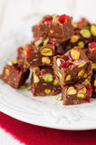 Chocolate Fudge with Glace Cherries, Pistachios and Coconut. Copy space for your text Royalty Free Stock Photos