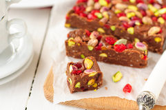 Chocolate Fudge with Glace Cherries, Pistachios and Coconut. Copy space for your text Royalty Free Stock Images