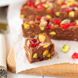 Chocolate Fudge with Glace Cherries, Pistachios and Coconut. Square Royalty Free Stock Photo