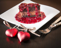 Chocolate ganache mousse cake with raspberry sauce Royalty Free Stock Photo
