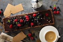 Chocolate ganache tart with fresh berries Stock Images