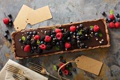 Chocolate ganache tart with fresh berries Stock Image