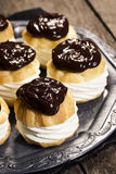 Chocolate Ganache Topped Creampuffs or Profiteroles Stock Images
