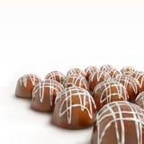 Chocolate gathering. Delicious dark, milk, and white chocolate pralines Stock Image