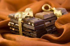 Chocolate gift on the silk. Chocolate gift on the brown silk Royalty Free Stock Photography