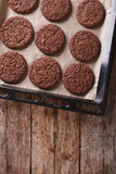 Chocolate gingerbread cookies on the baking sheet. vertical top Stock Photo
