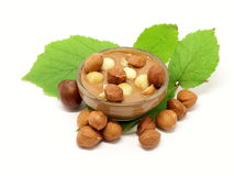 Chocolate in glass bowl with hazelnuts and leafs Royalty Free Stock Photos