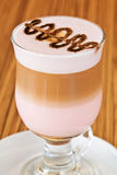 Chocolate on the glass of latte macchiato Stock Image