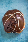 Chocolate glazed artisan donut, overhead Royalty Free Stock Photography