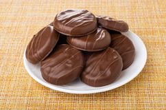 Chocolate cookies in plate on mat royalty free stock photo