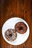Chocolate glazed donuts Stock Image