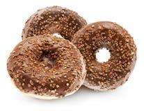 Chocolate glazed donuts isolated on white background Stock Images