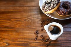 Chocolate glazed donuts with mug coffee Stock Images