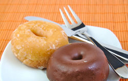 Chocolate and glazed doughnut on wooden background Stock Image