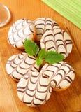 Chocolate-glazed mini cakes Stock Photography