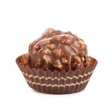 Chocolate gold bonbon with nuts. Stock Photo