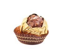 Chocolate gold bonbon with nuts. stock photography