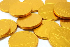 Chocolate gold coins, randomly scattered Royalty Free Stock Photography