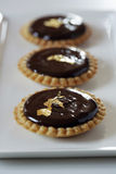 Chocolate and gold leaf mini tartlets Stock Image