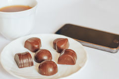 Chocolate. Good morning chocolate phone effect smell white Tea coffee Royalty Free Stock Photography