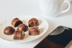 Chocolate. Good morning chocolate phone effect smell white Tea coffee Stock Images