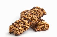Chocolate granola bars isolated on white background. Healthy sweet dessert snack. Cereal granola bars with nuts and chocolate on stock photos