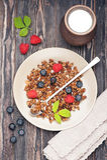 Chocolate granola and fresh berries Stock Photos