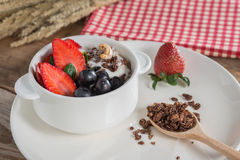 Chocolate granola with fresh strawberry, greap, almond and yogur Royalty Free Stock Photography