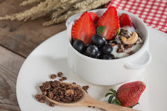 Chocolate granola with fresh strawberry, greap, almond and yogur Royalty Free Stock Photo