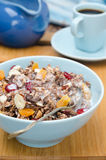 Chocolate granola with nuts, dried fruit and milk closeup Stock Photography