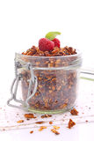 Chocolate granola with nuts in a jar Stock Image