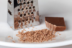 Chocolate grater and crumbs Royalty Free Stock Image