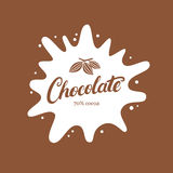 Chocolate hand written lettering logo, emblem, badge or label with splash and cocoa bean. Royalty Free Stock Photography